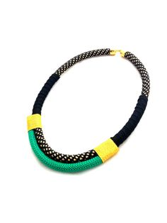 www.cewax.fr love this statement necklace ethno tendance, style ethnique, #Africanfashion, #ethnicjewelry - CéWax aussi fait des bijoux : http://www.alittlemarket.com/collier/fr_collier_plastron_multi_rang_ethnique_en_tissu_africain_beige_prune_jaune_-15921837.html - Ce collier est classe, féminin et élégant. Il peut se porter en toute occasion. - Fait main - Pièce unique - Matériaux : corde noire