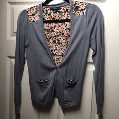 Banana Republic stone blue cardigan BR stone blue cardigan with super cute 100% silk floral back and pocket details Banana Republic Sweaters Cardigans