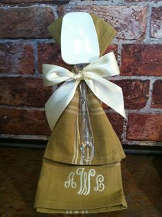 hostess gift...dishtowels & spatula tied with pretty ribbon