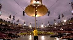 Tour de France champion Bradley Wiggins opens the Olympic Opening Ceremony by ringing a giant bell