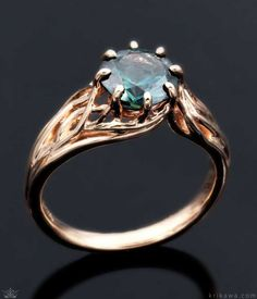 Embracing Tree Branch Engagement Ring in 14k rose gold and with a round green sapphire. Love the design and want to make it your own. Choose your favorite metal and solitaire stone at krikawa.com!