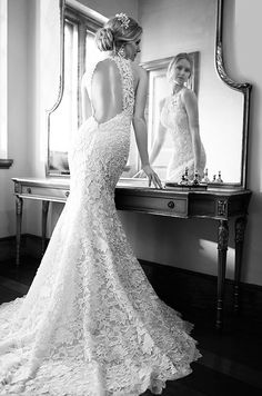 Vintage-style corded lace over satin fit-and-flare wedding dress from Spring 2015 Martina Liana bridal collection.