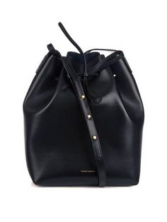 I have a bucket bag and have not put it down all season. This clean lined leather number is sizable enough for every day use and portfolio toting as well as cinched up tight and hot for nighttime transitions. I am eyeing this one for a replacement… $611 Large vegetable-tanned leather bucket bag   Mansur Gavriel   M...