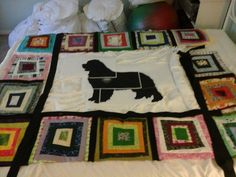 This is my SAS Quilt.   Yesterday I went to kinko's and enlarged @ 300% the newfoundland dog that I want to put in the center of the quilt.   At the moment it is a paper pattern that I will have to tape and then cut out.   Next I will use it to trace the real newfie out of black fabric.   I have to admit I am extremely happy with how it is coming together.