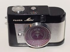 "Fujica Mini was a half frame camera developed targeting female users. The camera body is compact so that it can be put into a pocket or hand bag, and its appearance is stylish. The camera was designed by the combination of Masaki Nishimura and Yoshio Tanaka, who designed the cult camera ""Fuji Pet"". Stylish little camera."