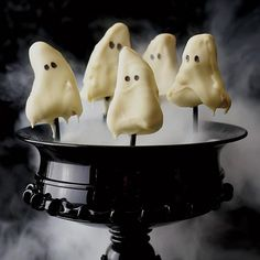 Ghostly Lemon Cake Pops | Grace Parisi's cake pops are easy to make: Crumble store-bought pound cake; mix with lemon, sugar and butter; then shape into mounds. When they're covered with white chocolate, the cakes look like ghosts. Make their faces with an edible decorating pen or dots of black frosting.