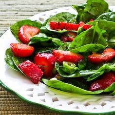 Strawberry Spinach Salad with homemade dressing - candied pecans would taste great with this too along with some feta cheese