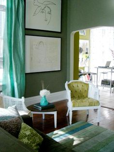 The color palette in this living room includes shades of turquoise, jade green and yellow-green for a cohesive and sophisticated look. Rate My Space user merskine unifies her eclectic mix of furniture from Craigslist by painting the wood pieces a bright white and using an analogous color palette.