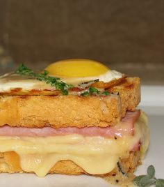 Croque Madame Grilled Ham And Cheese With Fried Egg And Creamy Mornay Sauce