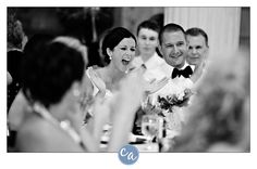Bride laughing during toasts at The Old Courthouse