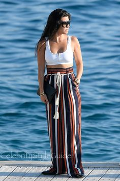Kourtney Kardashian and Tularosa Keeton Pants, Varley Beth Crop Top, Gucci Princetown Mule Loafer, Celine Adele Sunglasses. See the latest Kourtney Kardashian style, fashion, beauty, trends, wardrobe and accessories.
