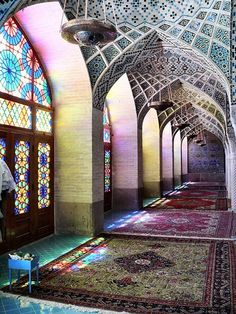 stunning colour filtering through the stained glass. Note also the carpets and the repeating geometric designs on the walls and ceiling