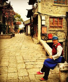 A Naxi lady along a lane in Lijiang, China. via instagram by endless_traveler