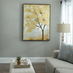 Step up your decor game with our Gold Leafed Tree Framed Art Print! The soft grey background compliments the subtle shimmer from the gold-foiled leaves.
