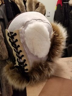 Sheepskin bondage mask with massive fur trim and exposed mouth