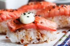 Blowtorched Salmon Nigiri with Ginger-Lime Caramel Drizzle and a Dollop of Wasabi Mayo