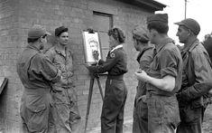Elizabeth Black doing a charcoal portrait in the 1940s.