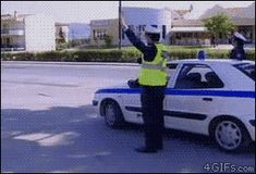 I love that the other cop starts laughing.