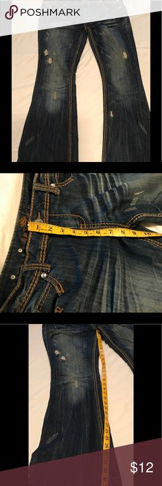 "Almost Famous distressed jeans An awesome pair of Almout Famous boot cut jeans in EUC with no stains.  These jeans are a size 13 and measure 33"" at the inseam and have an 8"" rise. Cotton/polyester/spandex blend for easy care and comfortable wear. All reasonable offers welcome. Almost Famous Jeans Boot Cut"