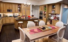 """Modern Family  The cluttered epicenter of an on-the-go American family The kitchen in Phil and Claire Dunphy's house is not meant to be relaxing or peaceful. """"This set reflects true family life, where it feels lived-in and highlights the busyness that every day brings,"""" says production designer Claire Bennett, who took over for the [...]"""