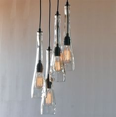 """This is a 4-Light pendant chandelier made from three 16"""" long cut glass bottles. These wide mouth bottles will accommodate several lightbulb styles. Four 40 watt bulbs are included. Please select your chandelier length based on your ceiling height. You can also choose your desired finish for the metal work in the drop down menu. …"""
