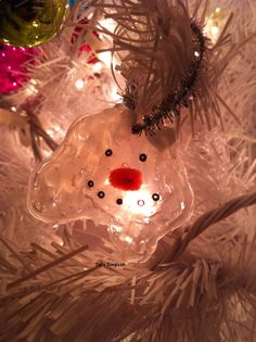 Melted snowman hot glue ornament.