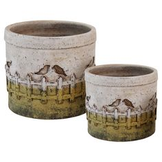 Add a rustic-chic touch to your entryway console table or living room mantel with this charming planter set, crafted from terracotta and showcasing a fence m...