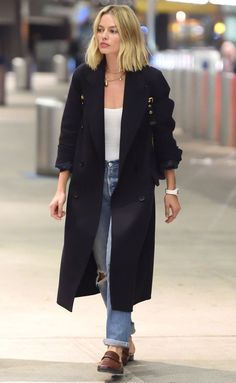 Margot Robbie in a black long coat, boyfriend jeans and loafers - click through for more fall outfit ideas