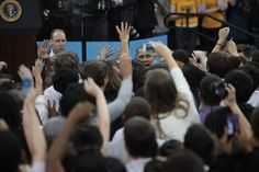 Obama shakes hands with students after his speech.