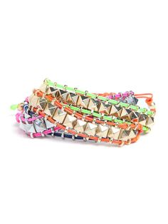 Keep your wrist under wraps in the most stylish tough-chic way, in a stud covered style in a bevy of colorful options.