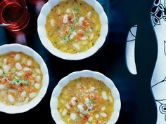 White-Bean Soup with Bacon and Herbs | A light broth loaded with chunky Great Northern beans and topped with a sprinkling of bacon, this soup was inspired by the caldo gallego (a Spanish wh...