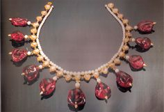 Spinel necklace of Mughal Emperors There are eleven Spinel beadsin the necklace with uncut diamonds and three of the beads are inscribed with the names of Mughal Emperors Akbar, Jahangir and Shah Jahan