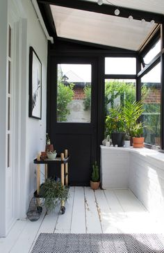 See how I gave our tired old sunroom a fresh botanical scandi garden room makeover, transforming it from a boring magnolia box into a minimalist sunroom with painted black window frames and white brick walls, looking out onto our garden. Nordic Interior, Interior Design, Interior Stylist, Sas Entree, Ideas Terraza, Sunroom Decorating, Building A Porch, Side Porch, House With Porch