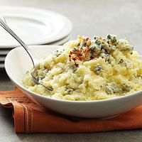 Blue Cheese-Garlic Potatoes    3 pounds russet or Yukon gold potatoes, peeled and cubed  1 1/2 teaspoons salt  1/4 cup olive oil  2 garlic cloves, thinly sliced  4 ounces crumbled blue cheese  Crushed red pepper flakes