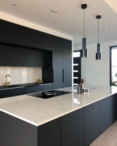 We are seeing a trend with matte black kitchens! Balance out your space with a lighter counter surface, like Dekton Tundra. #KitchenCabinets