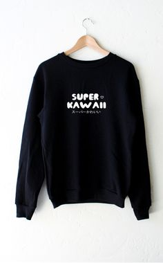- Description - Size Guide Details: Super soft oversized crew neck fleece sweatshirt in black with print featuring 'Super Kawaii' by NYCT Clothing. Oversized, Unisex fit. 50% Cotton, 50% Polyester. Ma