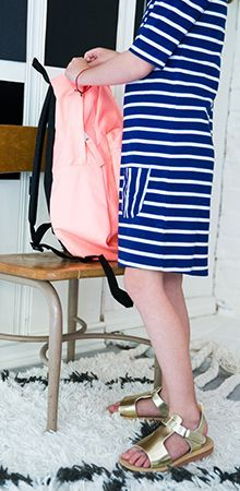 Love how Liz from Say Yes blog goes bold for Back to School. Pair a bright pink backpack with a blue striped dress and metallic gold sandals for her first day back to school.