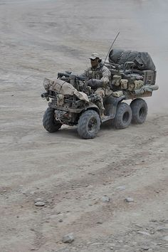 A commando from the Commando Regiment returns to Tarin Kowt on his All Terrain Vehicle (ATV) after lengthy operation in Southern Afghanistan. Army Vehicles, Armored Vehicles, Bug Out Vehicle, Terrain Vehicle, Quad Bike, 4 Wheelers, Expedition Vehicle, Military Equipment, Off Road