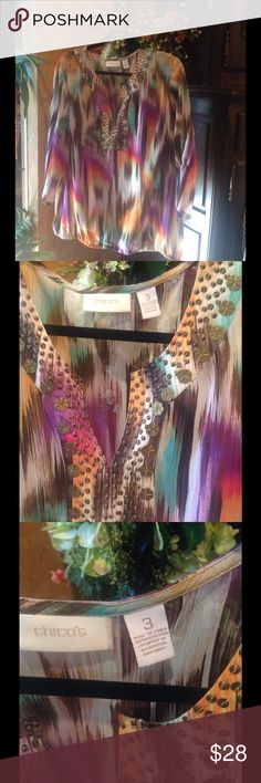 Colorful Sheer Long Sleeve Top Hand sewn brass beads adorn this v-shape neckline.  Sheer fabric is 100% polyester. Sheer Top is 100% fun! 🌟 Chico's Tops