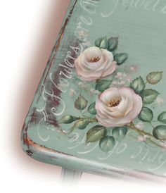 Painted cottage roses on a wooden chair