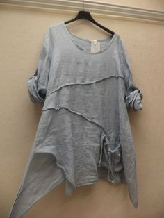 QUIRKY LINEN TOP - I'd have to cut those rolled up sleeves off, but the rest is my style for sure...