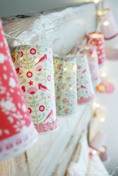 Standard covered paper cups covered with fabric & braid, & used as fairy light light shades.....would be sweet to pierce some small holes in the cups too. So the light can twinkle out
