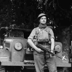 A soldier of the Lowland Division poses with his Thompson sub-machine gun and a Bedford MWD truck in France, June 1940 Possibly from the Royal Scots looking at the markings on the vehicle. British Soldier, British Army, Military Photos, Military History, British Commandos, Navy Uniforms, Military Uniforms, Political Beliefs, Operation