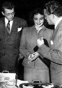 """Birthday gal Jennifer Jones is sandwiched between husband Robert Walker and her lover David O. Selznick on the set of """"Since You Went Away"""""""