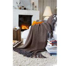 Prunk-Stück: Diese selbstgemachte Wolldecke verwandelt Ihr Sofa zur royalen Sitzgelegenheit. Hier gibt es die Anleitung.