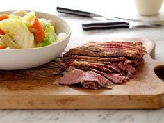 Corned Beef and Cabbage: Tyler Florence treats brisket to a flavor-packed brine before slow-cooking it for hours in a Dutch oven to ensure tender results. Hearty root vegetables, cabbage and herbed butter fill up the rest of a plate worth the wait.