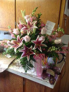 White Roses, Star Gazer Lilies, and Snap Dragons Floral Mache Arrangement