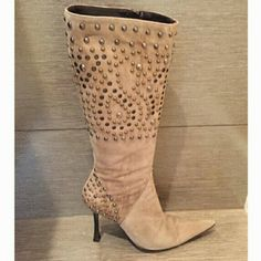 Beige suede BCBG boots with studs pointy toe Beige suede BCBG boots with studs pointy toe ,4.5 inch heal good condition , under the knee hight of the boot , side zippers no scratches on the heal BCBG Shoes Heeled Boots