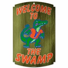 """NCAA Florida Gators Wood Sign by WinCraft. $17.99. Approximately 11'x17"""" in size. Made in the USA. Made with 1/4"""" thick hardboard wood. Decorated with dynamic team graphics. Perfect touch to a fans favorite room. Hardboard wood signs are 1/4"""" thick, decorated with quality graphics to resemble   an antique wood finish. A matte finish laminate top is added for greater durability   and a precision cut smooth edge makes this a great indoor decor sign. Made in USA"""