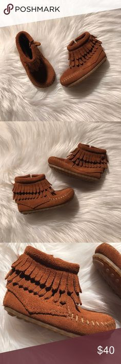 Toddler Minnetonka moccasins Adorable new baby Minnetonka moccasins! These were purchased new & never worn. Zip closure & rubber bottoms for traction. Perfect for this fall!   Baby Size 3 Minnetonka Shoes Moccasins
